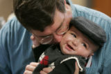 Jim Schuler (cq) kisses his son Connor as he and his wife DiAnn (cq caps) Schuler completed the...