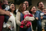Some of the 22 families that adopted 23 children today at Arapahoe County Courthouse  as Adoption...