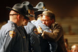 Dough Templeton (cq), the father of Colorado State trooper Zachariah Templeton (cq) hugs the...