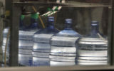 Fibe gallon bottles are filled and capped at the Deep Rock Water Company, 2633 California Street...