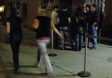 A roped off smoking patio hosts a group of people outside Herman's Hideaway in Denver, Colo.,...