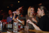 Rebecca Zilk (cq, second right) and Brooke Graff (cq, right) both of Denver, laugh while getting...