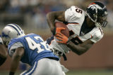 1521 Denver Broncos Brandon Marshall, right, gabs a pass as Detroit Lions Gerald Alexander tackles...