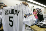 0247 workers Marian Diaz, left, and Sandra Olivas, right, prepare Rockies jerseys at Denver...