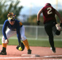 Wheatridge 1B  Miranda Mickelson beats out Ponderosa #2 Kelly Flynn for an out  in the ...