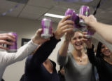 Karen Stronawski (cq), has a grape soda toast with other employees for IQ Navigator in the Denver...