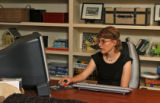 Amanda Wissmann, works on her computer, in her own living area Thursday afternoon, November 11,...