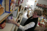 Volunteer Marge Wegscheider, puts together boxes of food for food bank clients at the Arvada Food...