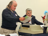 L to R: Rocky Rushing (cq) and Scott Hogensen (cq), Deputy Elections Director, continue counting...