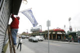 0220 George Walters, CQ, 69, puts up a Colorado Rockies flag as he prepares The Souvenir Store for...