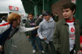 [293] Boston resident and Red Sox fan Joe Pinciaro, 23, left, leans into Rockies fan and Boston...