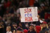 [534] A Boston Red Sox fan holds up a sign during the  commanding win of Game 1 of the World...