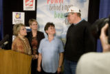 DM0407   Colorado's first Powerball jackpot winners Stanislawa, center, and Eugen, right,...