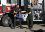 Dave Elin (cq), left, helps Marty Sugar (cq), gets his truck ready for departure, Thursday...