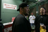 [1237] Colorado Rockies fans Cody DeWitt, 21, and Randy DeWitt, 45, Superior share a beer before...