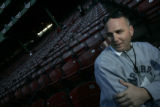 [606] Bill Ripken,cq, speaks with a reporter from the seats of Fenway Park before Game 2 of the...