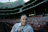 [615] Bill Ripken,cq, speaks with a reporter from the seats of Fenway Park before Game 2 of the...