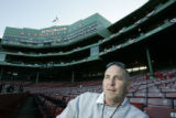 [616] Bill Ripken,cq, speaks with a reporter from the seats of Fenway Park before Game 2 of the...