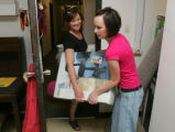 Lauren Jennings (cq), 18, right, helps her mother Brenda Jennings (cq), with a box as she moves...