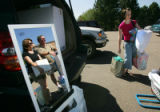 Parents Brenda Jennings (cq), left, and Richard Jennings (cq), center left, are reflected in a...
