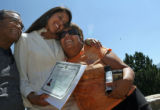 (from left), Humberto Garcia (cq) embraces his daughter, 24 year-old Mercedes Rodriguez (cq), as...