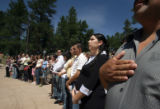(at right) Jesus Arturo Pena (cq) places his hand on his heart, as he takes the oath of allegiance...