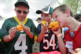 Bryce Reedy, 11, left, of Parker, Colorado, and his brothers Reece, 9, and Teague, 8, eat their...