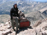 CODER102-Sheila Townsend stands on top of Long's Peak in Rocky Mountain National Park. The photo...