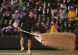"Colorado Rockies grounds crew were forced to constantly lay down ""diamond dust"" on the..."