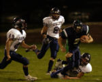 (Highlands Ranch, Co.-Sept. 16,2004)  ThunderRidge's quarterback Kyle Black is stopped on a 2nd...