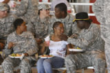 Members of the 1st Squadron, 6th Cavalry Regiment enjoy a meal with friends and family after the...