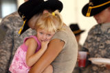 19 year-old Katie Leach (cq) holds her 3 year-old daughter, Catalina Leach (cq) after the ceremony...