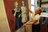 "Sharon hangs one of her most recent ""sisters"" themed paintings to be included in her..."