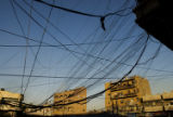 (NYT52) BAGHDAD, Iraq -- Aug. 22, 2007 -- IRAQ-ELECTRICITY -- A web of electrical wires on a...