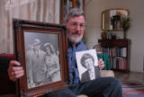 Dennis Nelson poses at his Bethesda MD home with 1941 photo of his parents Pershing Nelson and...