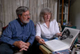 "Dennis Nelson and Denise Nelson looks through the book ""American Ground Zero, The Secret..."