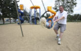 Tim Ellis has fun with his daughter Kiley, 2 at a local park before Kiley has a nap and Tim has a...