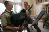 Richard Ellis teaches guitar to student Matt Smith, 12, at his family home in Longmont, Colo. on...