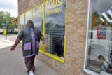 "Ed ""Big Tank"" Thomas (cq), owner of World Class Barbers Thursday August 23,2007. Thomas..."