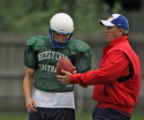John Elway, right, talks to his son, Jack Elway during football practice, Thursday afternoon,...