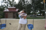 Kristin Ellis play with her daughter, Kiley, 2, at a local park before Kiley has a nap and Tim has...