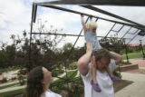 Tim and Kristin Ellis play with their daughter, Kiley, 2, at a local park before Kiley has a nap...