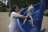 Kristin Ellis encourages her daughter, Kiley, 2, at a local park before Kiley has a nap and Tim...