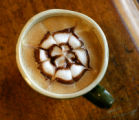 Hooked on Colfax co-owner Scott Spero designed this flower in this latte on Colfax Ave., in...