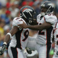 JOE1161 -Denver Broncos Simeon Rice, left, and Ian Gold celebrate in the third quarter against...