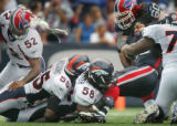 JOE424 - Buffalo Bills running back Marshawn Lynch loses his helmet as he is tackled by Denver...