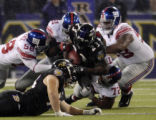 BAF102 - New York Giants defenders Antonio Pierce (58), Justin Tuck (91), Fred Robbins (98) and...