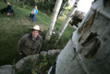 John Newkirk (cq)  looks at bear claw marks in an aspen tree next to his Evergreen home  Friday...