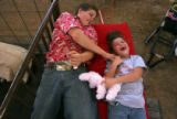 Patrick Rhine (cq), 14, tickles his sister  Madison Lambert (cq), 6, both of Lewis, as they lie...