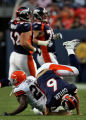[ES108] - Bronco's head quarterback Jay Cutler flips head over heals as he tries to make a tackle...